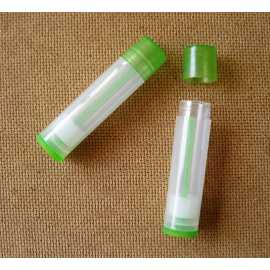 Vysouvací tuba na balzám na rty - transparentní zelená