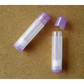 Vysouvací tuba na balzám na rty - transparentní fialová